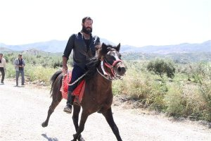 A Cretan man riding his horse at the 2012 racing event in Messara, Crete. Notice the special posture of the legs when the horse is on the run. Of course forget equestrian clothes (not even helmets, as you can see), rising trots and manners. The Cretan horse is just as resilient and brave as the Cretan people. Picture from http://alogomessaras.gr
