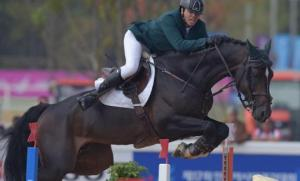 Saudi Arabia's Abdullah Waleed A Sharbatly (inset with medal) astride horse Callahan jumps over an obstacle during the equestrian jumping individual final at the Dream Park Equestrian Venue in Incheon. Picture from www.arabnews.com