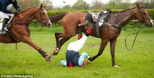 And here we go, fallen of the horse, with another horse coming! Yeah, fun (joke)! Picture retrieved from here http://www.dailymail.co.uk/news/article-2329690/I-thought-Horrifying-moment-jockey-knocked-dragged-200-yards-horse.html
